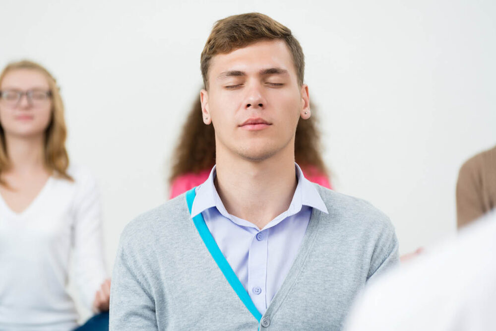 peaceful man meditating